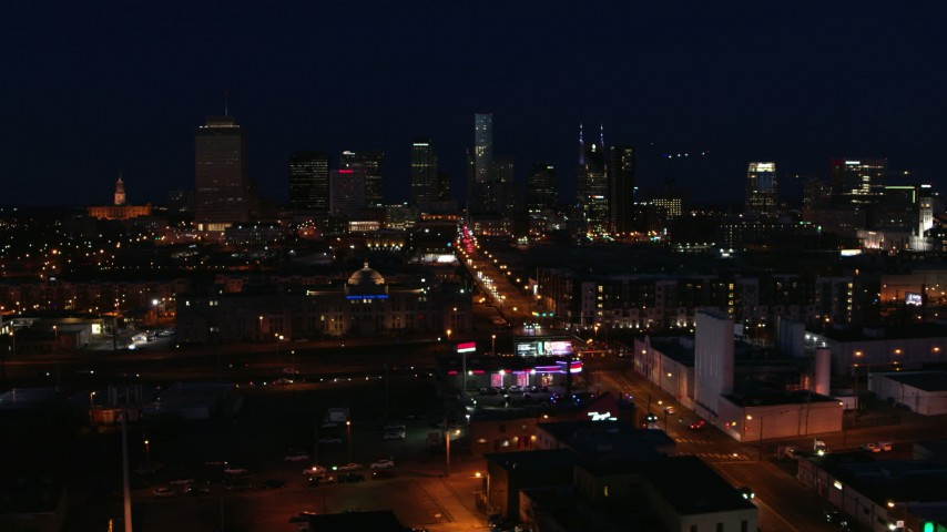 5.7K stock footage aerial video flyby flashing lights on Church Street at night, skyline in background, Downtown Nashville, Tennessee Aerial Stock Footage | DX0002_115_054