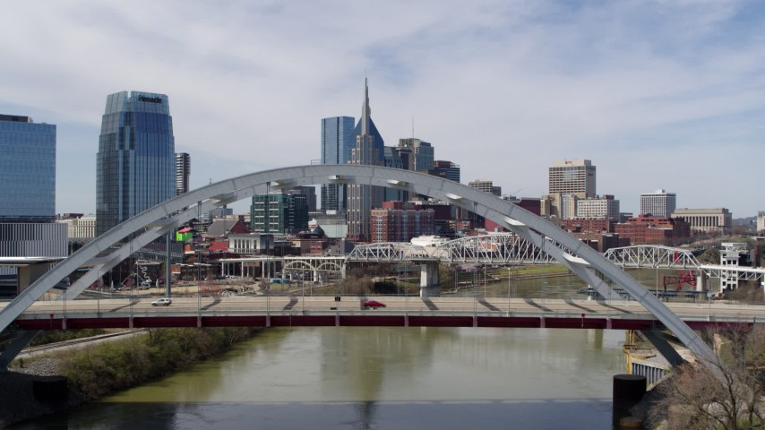 5.7K stock footage aerial video fly over bridge to focus on the AT&T Building in Downtown Nashville, Tennessee Aerial Stock Footage | DX0002_116_010