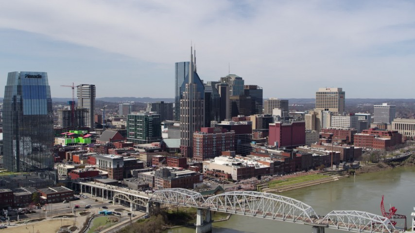 5.7K stock footage aerial video approach AT&T Building near bridge and Cumberland River in Downtown Nashville, Tennessee Aerial Stock Footage | DX0002_116_014