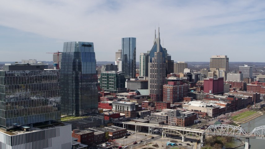 5.7K stock footage aerial video of flying by skyscrapers and reveal an office high-rise in Downtown Nashville, Tennessee Aerial Stock Footage DX0002_116_015