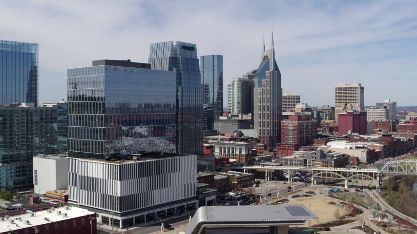 5.7K stock footage aerial video of descend near an office high-rise with view of AT&T Building in Downtown Nashville, Tennessee Aerial Stock Footage | DX0002_116_016