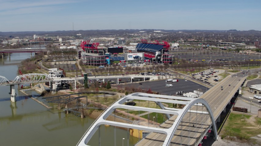 5.7K stock footage aerial video of Nissan Stadium seen from a bridge in Nashville, Tennessee Aerial Stock Footage | DX0002_116_017