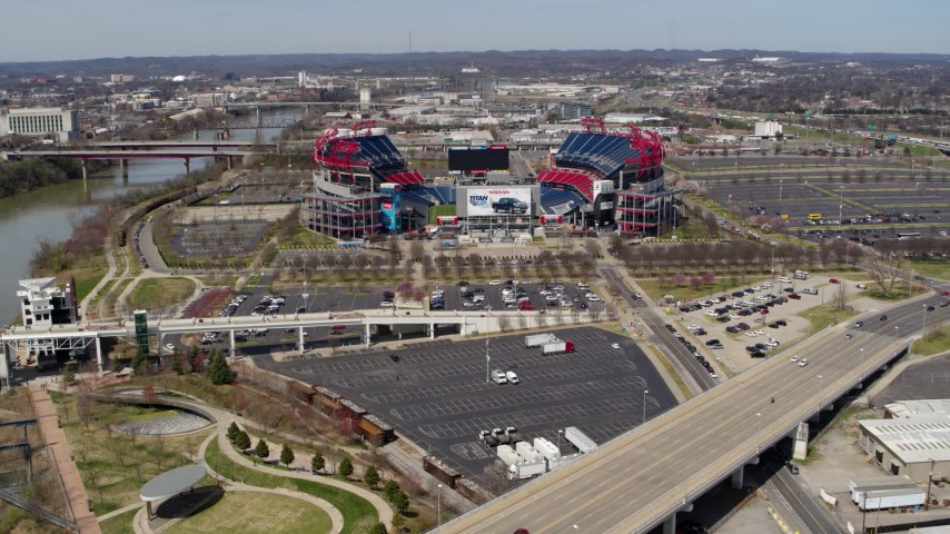 5.7K stock footage aerial video reverse view of Nissan Stadium seen from a bridge in Nashville, Tennessee Aerial Stock Footage | DX0002_116_018