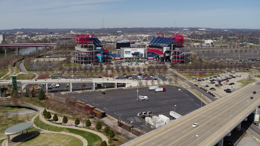 5.7K stock footage aerial video of Nissan Stadium while descending near a bridge in Nashville, Tennessee Aerial Stock Footage | DX0002_116_019