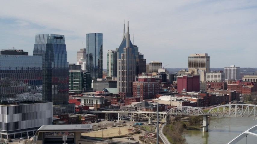 5.7K stock footage aerial video ascend near bridge to focus on the AT&T Building in Downtown Nashville, Tennessee Aerial Stock Footage | DX0002_116_034