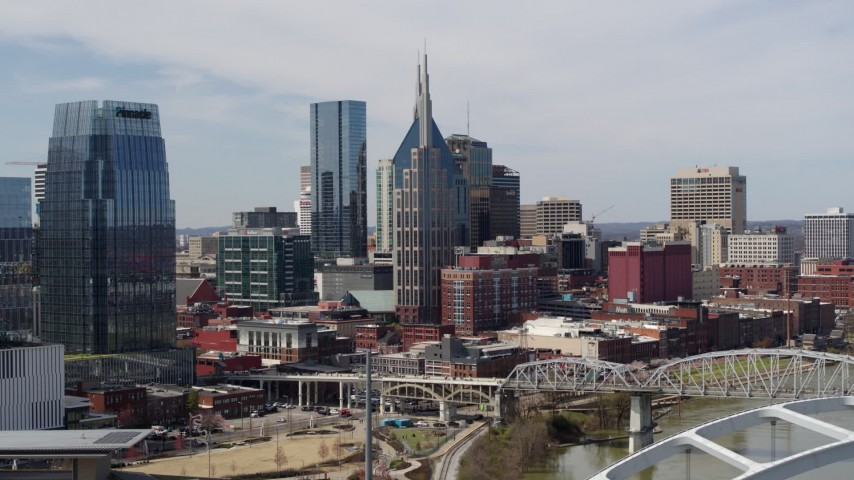 5.7K stock footage aerial video of a view the AT&T Building seen from the river in Downtown Nashville, Tennessee Aerial Stock Footage | DX0002_116_035