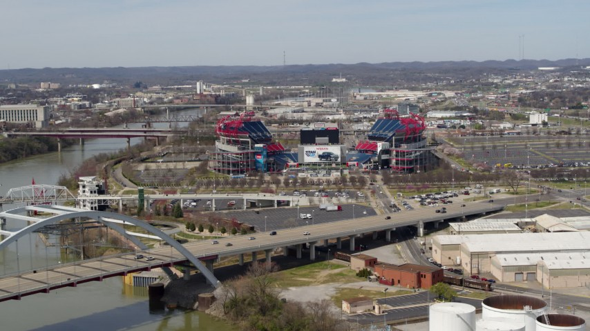 5.7K stock footage aerial video slow approach to Nissan Stadium from bridge in Nashville, Tennessee Aerial Stock Footage | DX0002_116_040