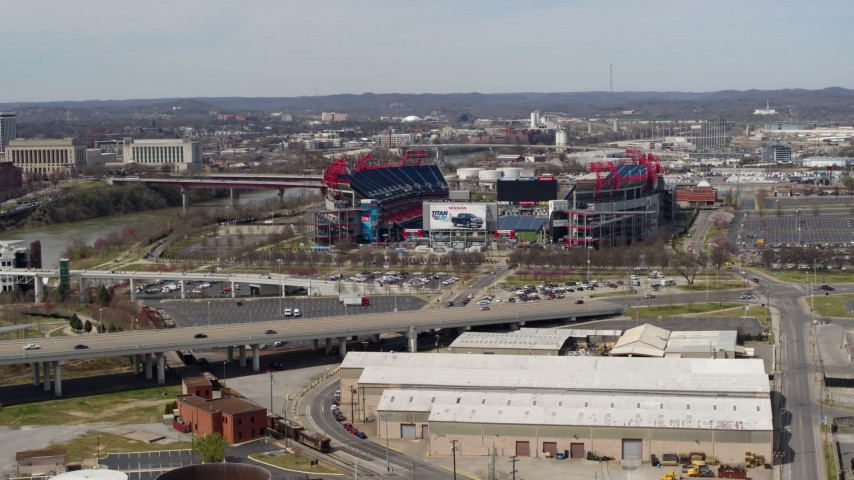 5.7K stock footage aerial video slowly flying away from Nissan Stadium near bridge in Nashville, Tennessee Aerial Stock Footage | DX0002_116_041