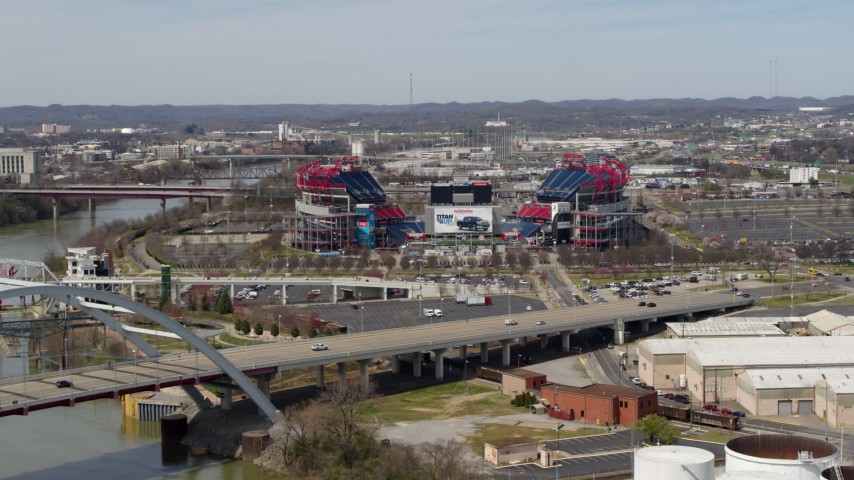 5.7K stock footage aerial video approach Nissan Stadium while descending near the bridge in Nashville, Tennessee Aerial Stock Footage | DX0002_116_044