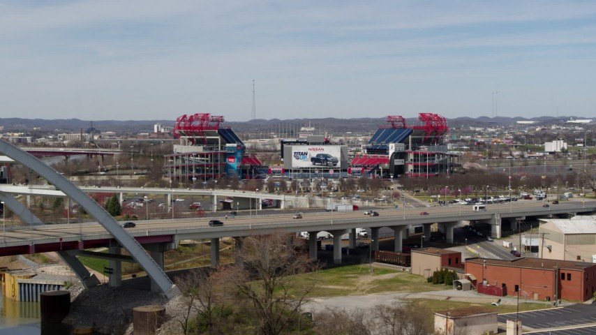 5.7K stock footage aerial video reverse view of Nissan Stadium behind the bridge in Nashville, Tennessee Aerial Stock Footage | DX0002_116_045