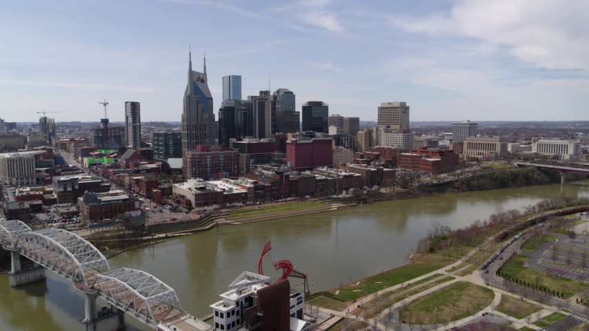 5.7K stock footage aerial video of the city's riverfront skyscrapers on the opposite side of the river, Downtown Nashville, Tennessee Aerial Stock Footage | DX0002_117_003