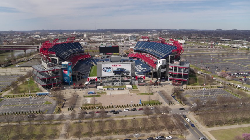 5.7K stock footage aerial video reverse view of Nissan Stadium during ascent in Nashville, Tennessee Aerial Stock Footage | DX0002_117_011