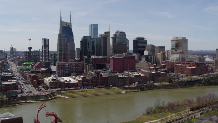 5.7K stock footage aerial video orbiting the city's skyline overlooking the Cumberland River, Downtown Nashville, Tennessee Aerial Stock Footage | DX0002_117_019