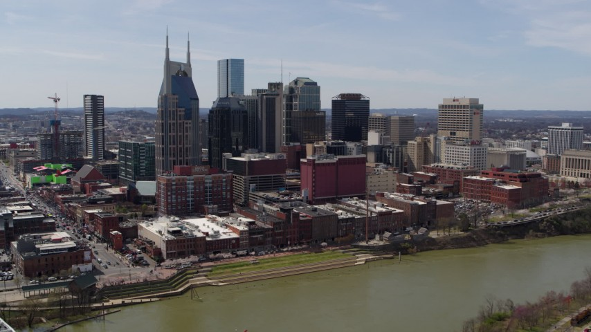 5.7K stock footage aerial video slowly orbiting the city's skyline overlooking the Cumberland River, Downtown Nashville, Tennessee Aerial Stock Footage | DX0002_117_020
