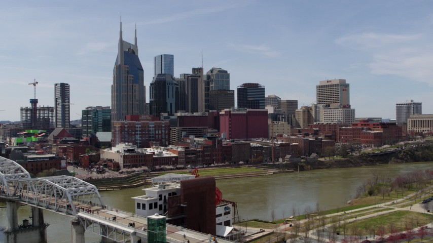 5.7K stock footage aerial video flying by the city's skyline overlooking the Cumberland River, Downtown Nashville, Tennessee Aerial Stock Footage | DX0002_117_022