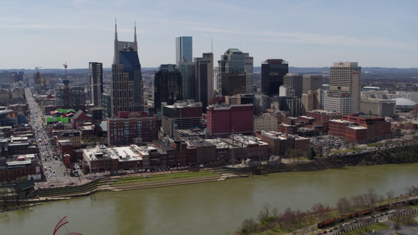 5.7K stock footage aerial video slow orbit of the city's skyline across the Cumberland River, Downtown Nashville, Tennessee Aerial Stock Footage | DX0002_117_027