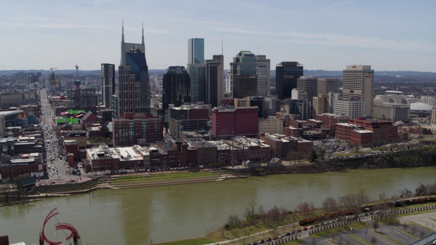 5.7K stock footage aerial video a view of city's skyline across the Cumberland River, Downtown Nashville, Tennessee Aerial Stock Footage | DX0002_117_028