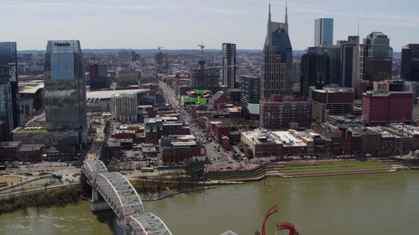5.7K stock footage aerial video crowded Broadway across the Cumberland River, Downtown Nashville, Tennessee Aerial Stock Footage | DX0002_117_029