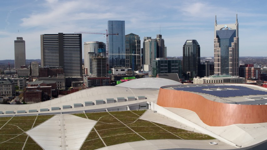 5.7K stock footage aerial video the city's skyline seen from convention center roof, Downtown Nashville, Tennessee Aerial Stock Footage | DX0002_117_038