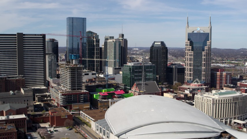 5.7K stock footage aerial video of flying by city's skyline, seen from the arena, Downtown Nashville, Tennessee Aerial Stock Footage | DX0002_117_042