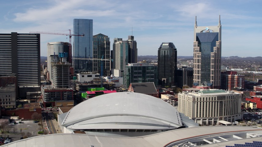 5.7K stock footage aerial video of the city's skyline, Bridgestone Arena, and Hilton hotel, Downtown Nashville, Tennessee Aerial Stock Footage | DX0002_117_050