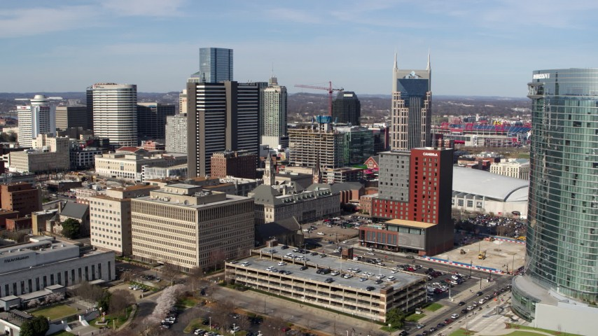 5.7K stock footage aerial video ascend and approach skyscrapers, city buildings in Downtown Nashville, Tennessee Aerial Stock Footage | DX0002_118_001