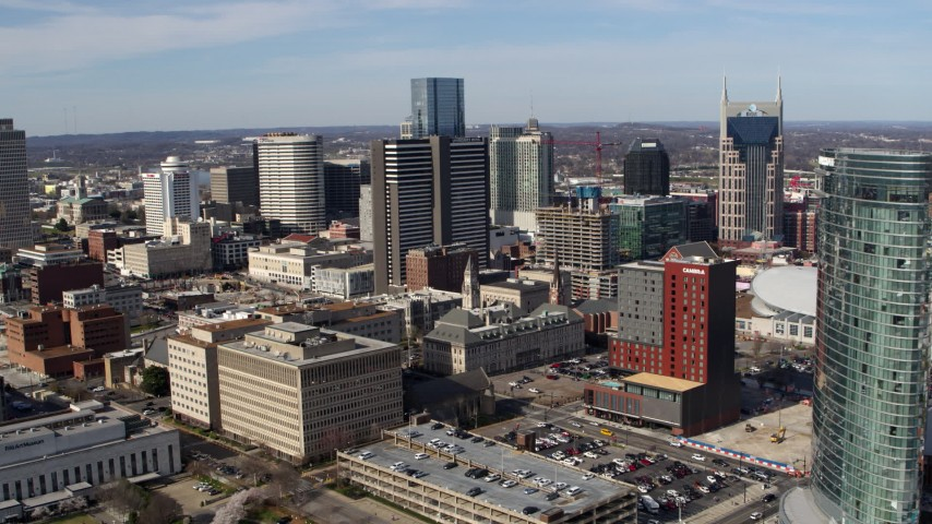 5.7K stock footage aerial video a reverse view of skyscrapers and city buildings in Downtown Nashville, Tennessee Aerial Stock Footage | DX0002_118_002