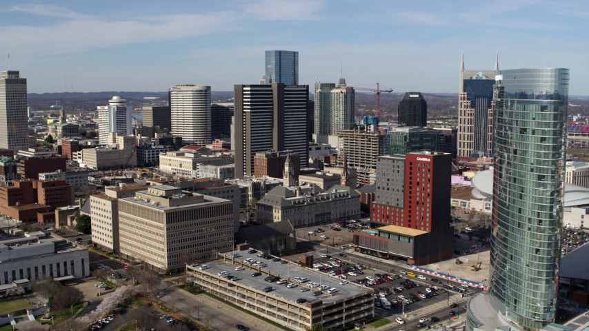 5.7K stock footage aerial video approaching and flying by skyscrapers, city buildings in Downtown Nashville, Tennessee Aerial Stock Footage | DX0002_118_003