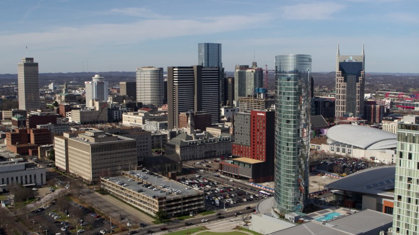 5.7K stock footage aerial video orbit the JW Marriott hotel, skyscrapers in background in Downtown Nashville, Tennessee Aerial Stock Footage | DX0002_118_013