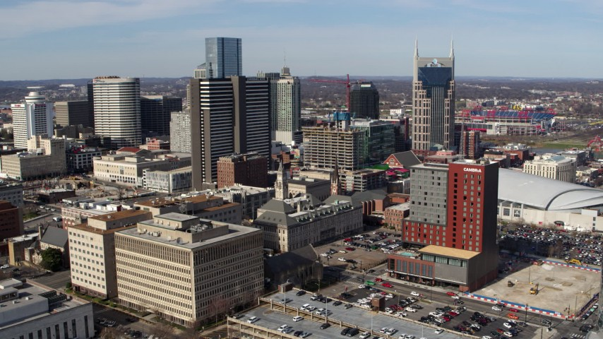 5.7K stock footage aerial video orbit city buildings near high-rise hotel and skyscrapers in Downtown Nashville, Tennessee Aerial Stock Footage | DX0002_118_014