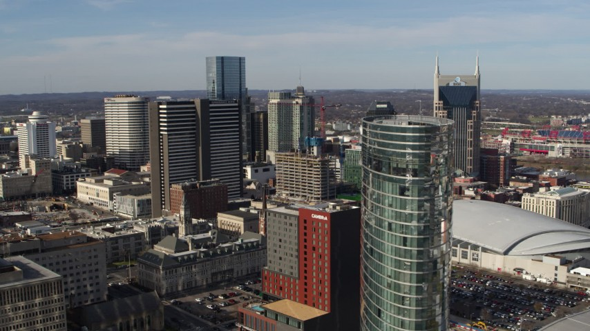 5.7K stock footage aerial video a reverse view of Renaissance Hotel, reveal JW Marriott hotel in Downtown Nashville, Tennessee Aerial Stock Footage | DX0002_119_001