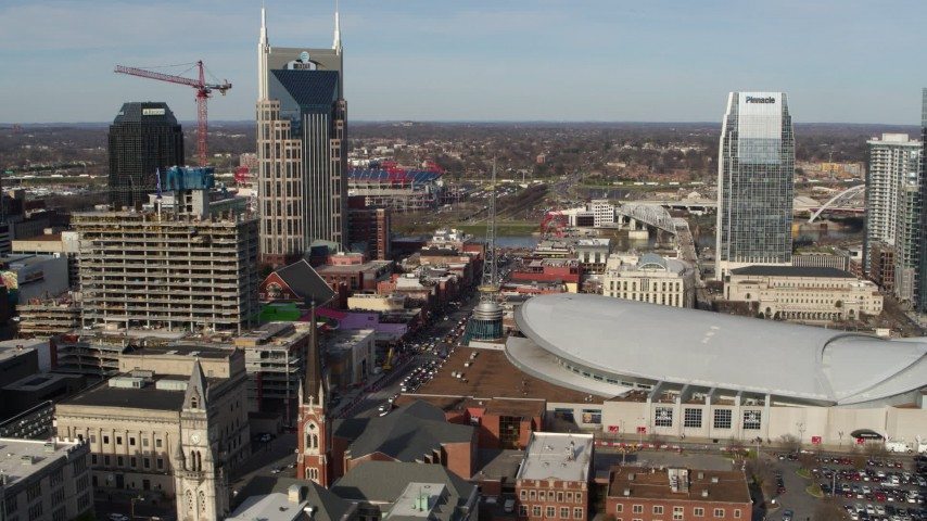 5.7K stock footage aerial video flyby Broadway and Bridgestone Arena in Downtown Nashville, Tennessee Aerial Stock Footage | DX0002_119_006