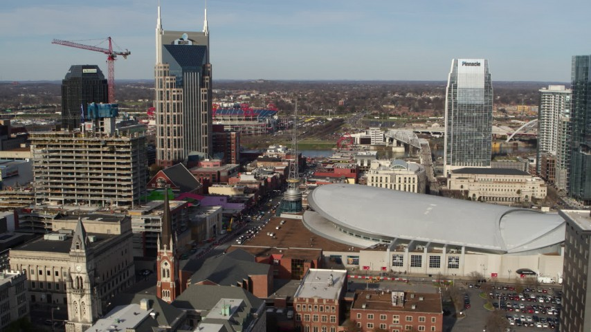 5.7K stock footage aerial video flyby top of hotel to reveal Broadway and Bridgestone Arena in Downtown Nashville, Tennessee Aerial Stock Footage | DX0002_119_007