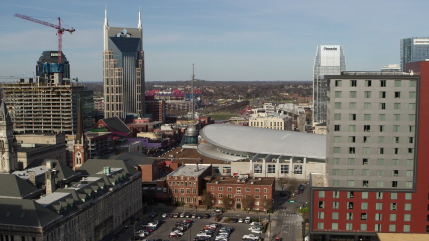 5.7K stock footage aerial video flyby Broadway and Bridgestone Arena, reveal hotel in Downtown Nashville, Tennessee Aerial Stock Footage | DX0002_119_008