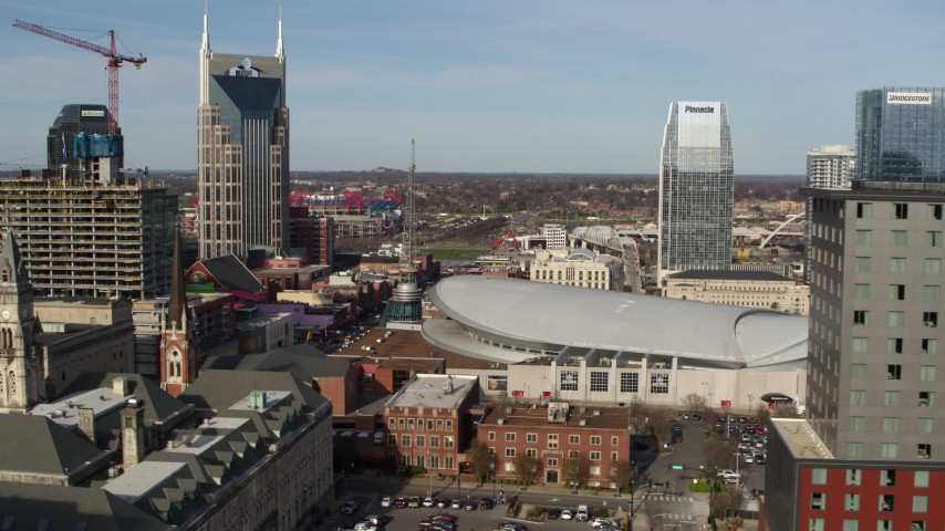 5.7K stock footage aerial video flyby hotel to reveal Broadway and Bridgestone Arena, Downtown Nashville, Tennessee Aerial Stock Footage | DX0002_119_009