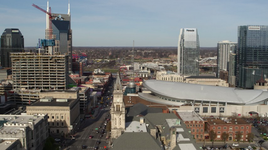 5.7K stock footage aerial video of Broadway and Bridgestone Arena, Downtown Nashville, Tennessee Aerial Stock Footage | DX0002_119_010