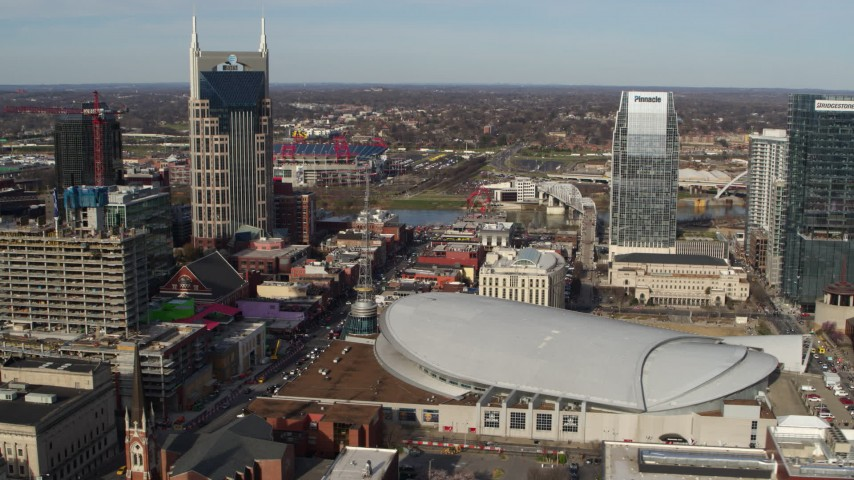 5.7K stock footage aerial video of AT&T Building, Broadway and Bridgestone Arena, Downtown Nashville, Tennessee Aerial Stock Footage | DX0002_119_011