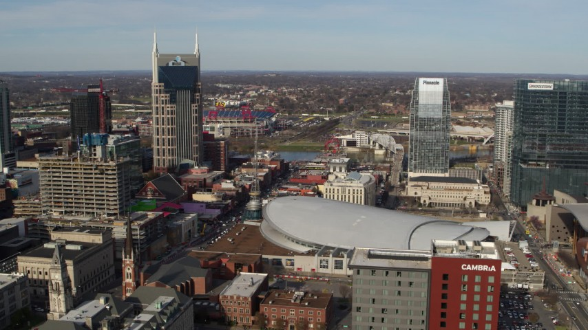 5.7K stock footage aerial video reverse view of AT&T Building, Broadway, Bridgestone Arena, Pinnacle skyscraper, Downtown Nashville, Tennessee Aerial Stock Footage | DX0002_119_012