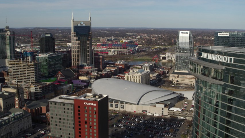 5.7K stock footage aerial video of AT&T Building, Bridgestone Arena, Pinnacle skyscraper, reveal JW Marriott hotel, Downtown Nashville, Tennessee Aerial Stock Footage | DX0002_119_013