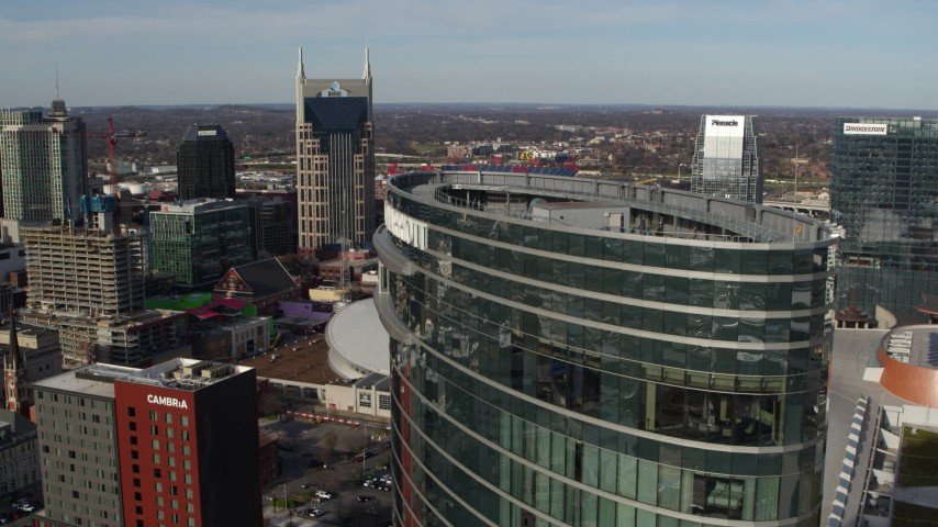5.7K stock footage aerial video flyby JW Marriott for view of AT&T Building, Bridgestone Arena, Pinnacle skyscraper, Downtown Nashville, Tennessee Aerial Stock Footage | DX0002_119_014
