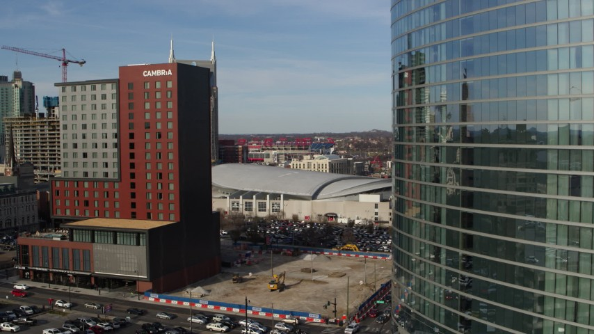 5.7K stock footage aerial video of Cambria Hotel and Bridgestone Arena during descent, Downtown Nashville, Tennessee Aerial Stock Footage | DX0002_119_017