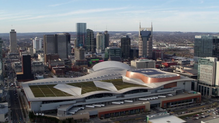 5.7K stock footage aerial video of Nashville Music City Center and the city's skyline, Downtown Nashville, Tennessee Aerial Stock Footage | DX0002_119_019