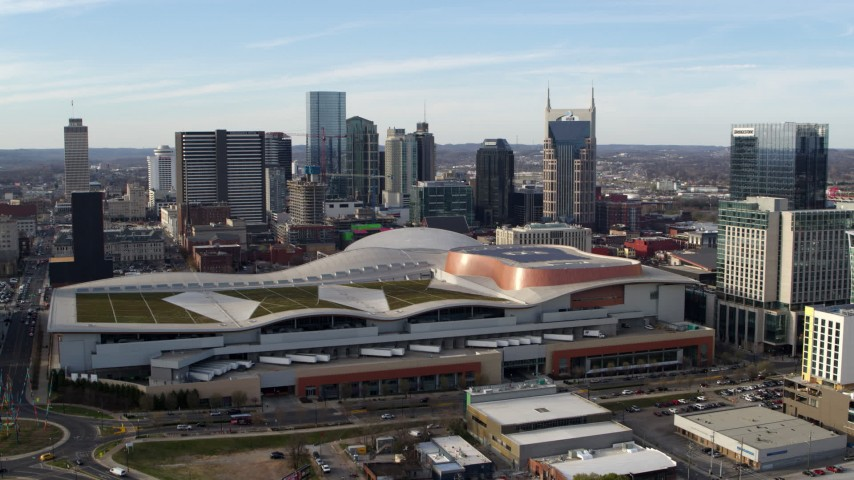 5.7K stock footage aerial video fly away from Nashville Music City Center and city's skyline, Downtown Nashville, Tennessee Aerial Stock Footage | DX0002_119_020