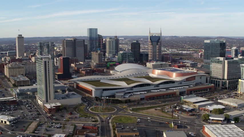 5.7K stock footage aerial video passing by Nashville Music City Center and city's skyline, Downtown Nashville, Tennessee Aerial Stock Footage | DX0002_119_022