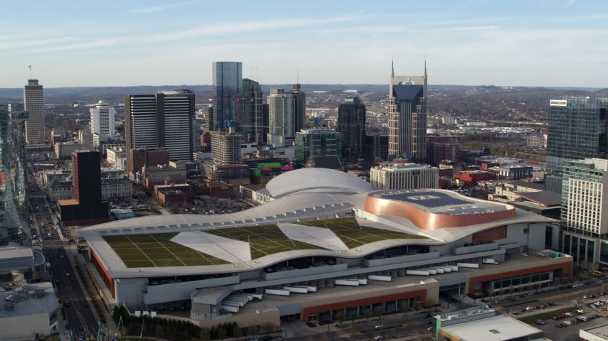 5.7K stock footage aerial video slow approach to Nashville Music City Center and city's skyline, Downtown Nashville, Tennessee Aerial Stock Footage | DX0002_119_023