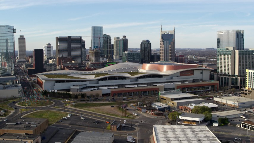 5.7K stock footage aerial video reverse view of Nashville Music City Center and city's skyline, Downtown Nashville, Tennessee Aerial Stock Footage | DX0002_119_025