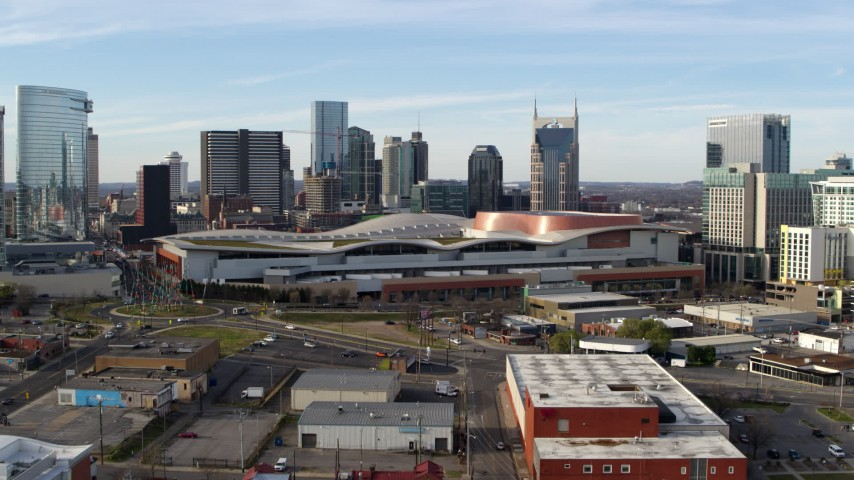 5.7K stock footage aerial video approach Nashville Music City Center and city's skyline during ascent, Downtown Nashville, Tennessee Aerial Stock Footage | DX0002_119_026