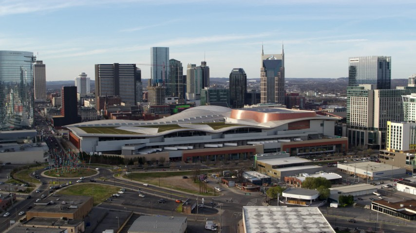 5.7K stock footage aerial video ascend and flyby Nashville Music City Center and city's skyline, Downtown Nashville, Tennessee Aerial Stock Footage | DX0002_119_029