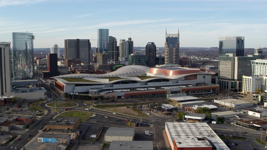 5.7K stock footage aerial video reverse view of Nashville Music City Center and city's skyline during descent, Downtown Nashville, Tennessee Aerial Stock Footage | DX0002_119_030