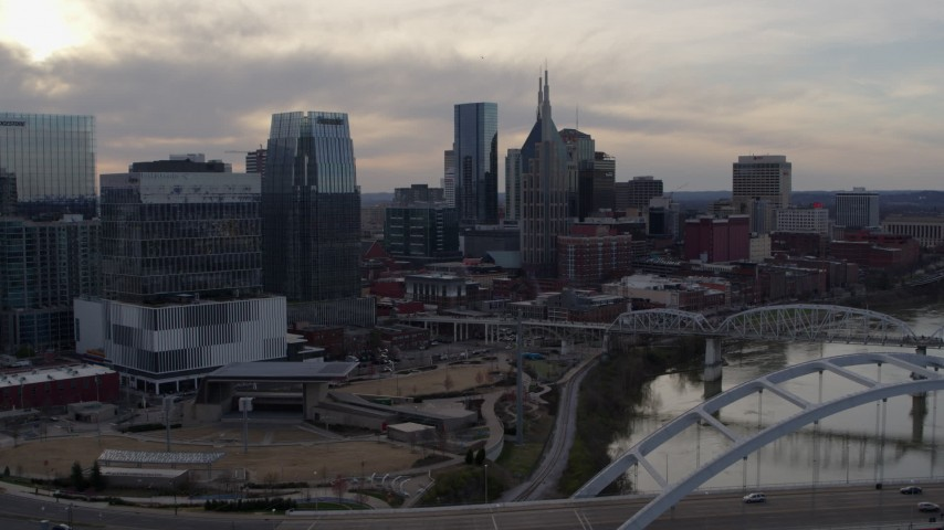 5.7K stock footage aerial video of the AT&T Building and city skyscrapers at sunset, Downtown Nashville, Tennessee Aerial Stock Footage | DX0002_119_036